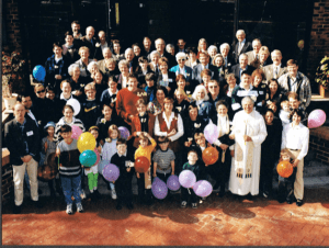 Parishioners gather outside the church on St Mary's 80th Patronal Day in August 1998.